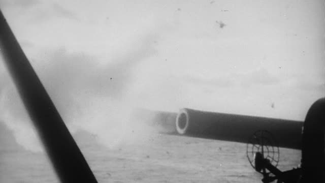 barrels of uss nevada's main battery 14 naval guns firing during world war ii / iwo jima, japan - battleship stock videos & royalty-free footage