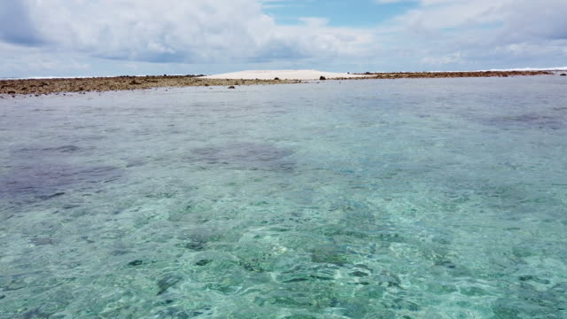 barren islet, stripped of vegetation from a past storm, is viewed in the funafuti atoll on november 26, 2019 in funafuti, tuvalu. the low-lying south... - view into land stock videos & royalty-free footage