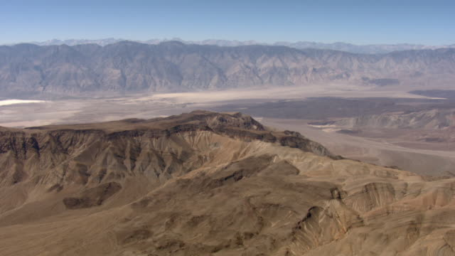 barren mountains tower above saline valley in death valley national park. - death valley national park stock videos and b-roll footage