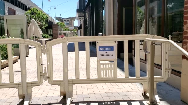 a barricade is erected to prevent trespassing at broadway plaza mall during an outbreak of the covid19 coronavirus in walnut creek california april... - trespassing stock videos & royalty-free footage