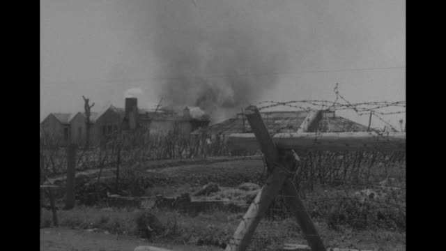 barricades and burning buildings around airfield in shanghai / destroyed building, pan across street to rubble / note: exact day not known - war stock videos & royalty-free footage
