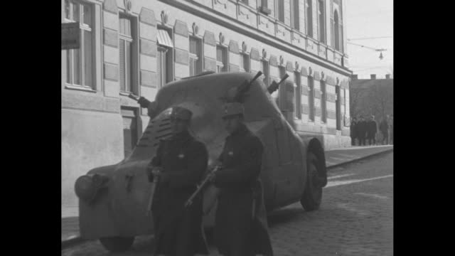 mls barricades set up across cobblestone streets of vienna during 1934 austrian civil war as civilians go about their business as normally as... - traditionally austrian stock videos and b-roll footage