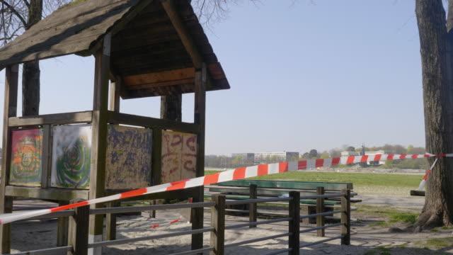barrier tape closing of playground - kinderspielplatz stock-videos und b-roll-filmmaterial