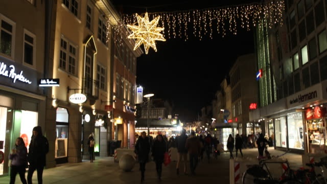 barriers made of concrete to counter terrorism are set up before the christmas market christmas market visitors stroll through the city center many... - advent calendar stock videos & royalty-free footage