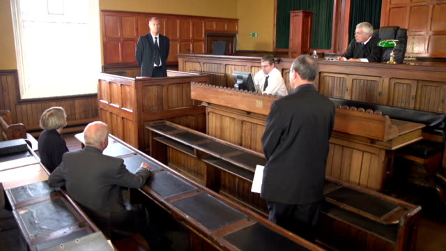Barrister Questioning Witness in Court case with Judge