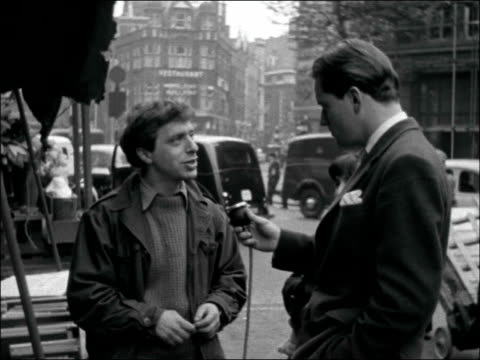 london ext bernard kops arranging books on bookstall / bernard kops interview sot found it very difficult earning a living being a writer / i... - reality fernsehen stock-videos und b-roll-filmmaterial