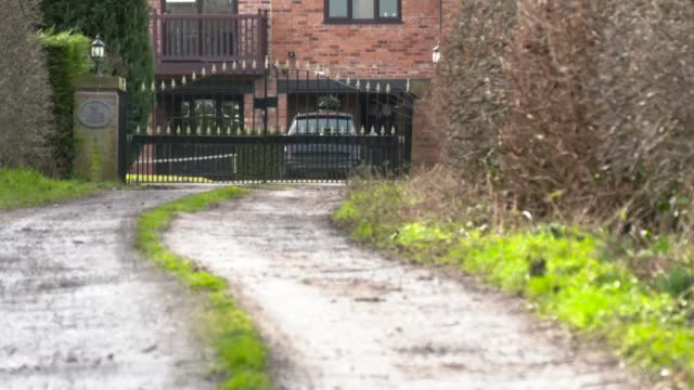 Crewe Alexandra say they knew nothing of his crimes ENGLAND Cheshire EXT Low angle view of the gates and house of former Crewe Alexandra Manager...