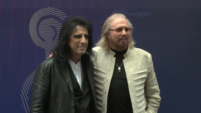 barry gibb alice cooper at grosvenor house on june 30 2017 in london england - ungestellt stock-videos und b-roll-filmmaterial