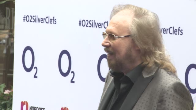 Barry Gibb Linda Gibb at Nordoff Robbins O2 Silver Clef Awards at Grosvenor House on July 01 2016 in London England
