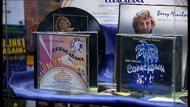 barry manilow album signing at shop under threat of closure; barry manilow interview sot - would rather do here than anywhere else, would like to... - barry manilow stock videos & royalty-free footage