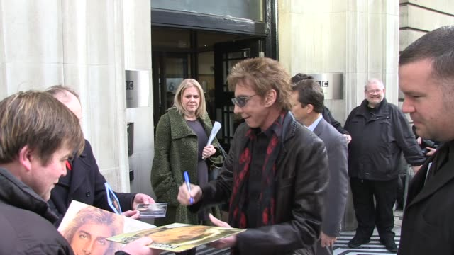barry manilow arrives at bbc radio two studios sighted: barry manilow at bbc radio studios on march 11, 2011 in london, england - barry manilow stock videos & royalty-free footage