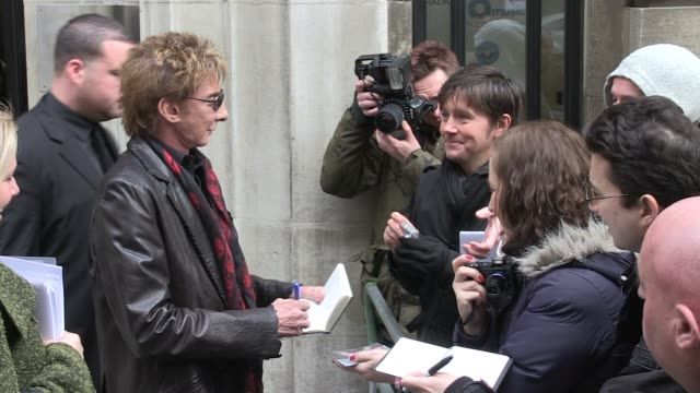 barry manilow leaves bbc radio two studios sighted: barry manilow at bbc radio studios on march 11, 2011 in london, england - barry manilow stock videos & royalty-free footage