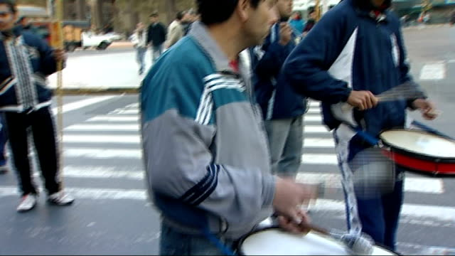 Bars music and tango in Buenos Aires ARGENTINA Buenos Aires EXT Various shots of demonstrators taking part in liberation movement protest march...