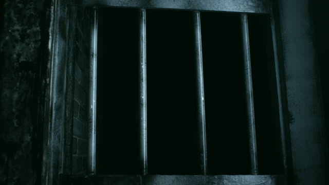 bars on empty prison cell - jail cell stock videos & royalty-free footage