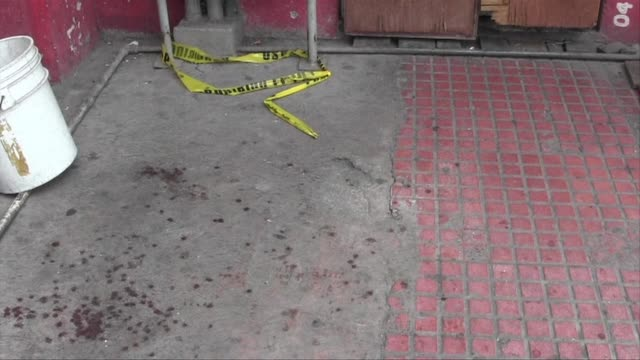 bars which were attacked overnight in the mexican state of monterray remain locked up and surrounded by a police presence after a series of deadly... - umgeben stock-videos und b-roll-filmmaterial