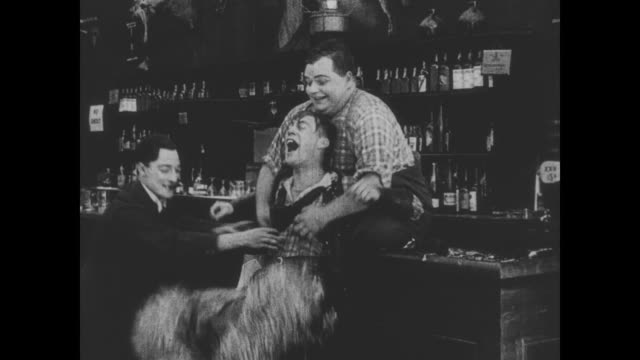 1918 bartender (fatty arbuckle) and man (buster keaton) discover one of wild bill hiccup's weaknesses, tickling - hiccup stock videos and b-roll footage