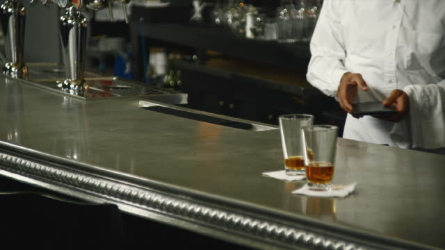 ms bartender cleaning up empty glasses at bar / seattle, washington, usa - dishcloth stock videos & royalty-free footage