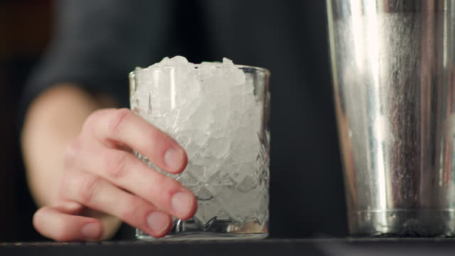 bartender emptying glass full of ice - drinking glass stock videos & royalty-free footage