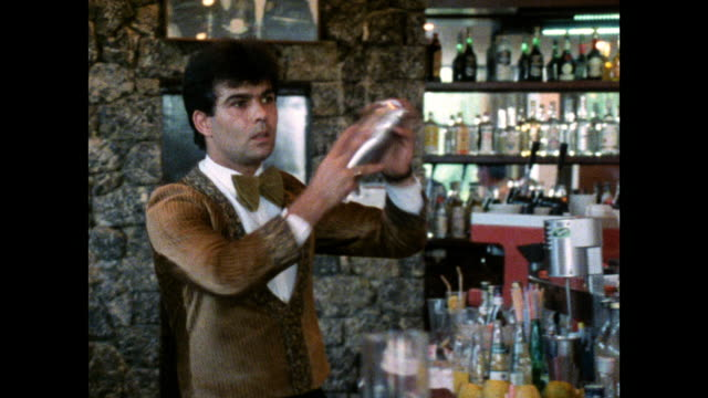 bartender makes cocktails at hotel bar; 1986 - bar area stock videos & royalty-free footage