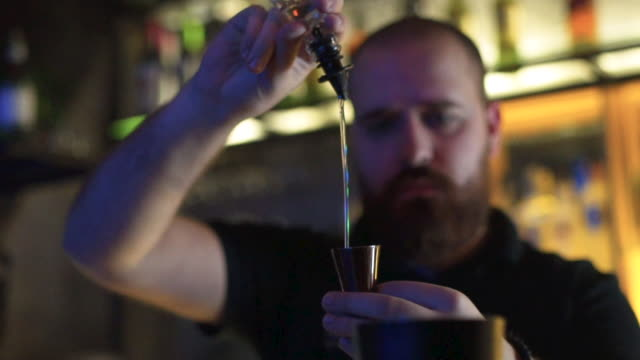 a bartender man pours a drink - bar drink establishment stock videos and b-roll footage