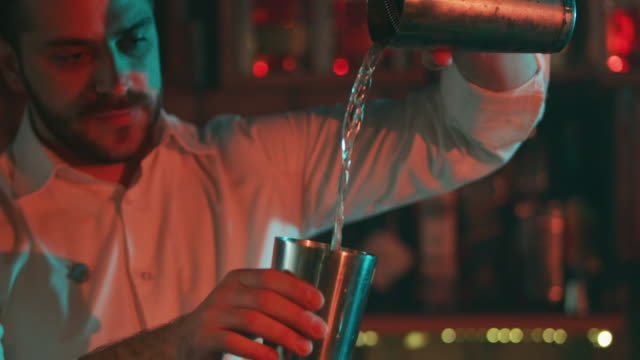 bartender mixing a drink 4k - bartender stock videos and b-roll footage