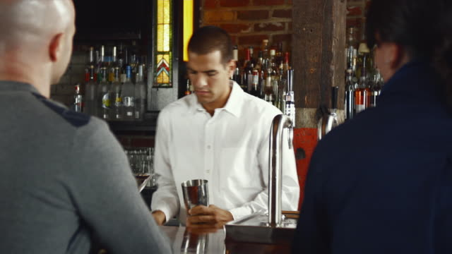 ms bartender mixing and pouring drink / seattle, washington, usa - bartender stock videos and b-roll footage