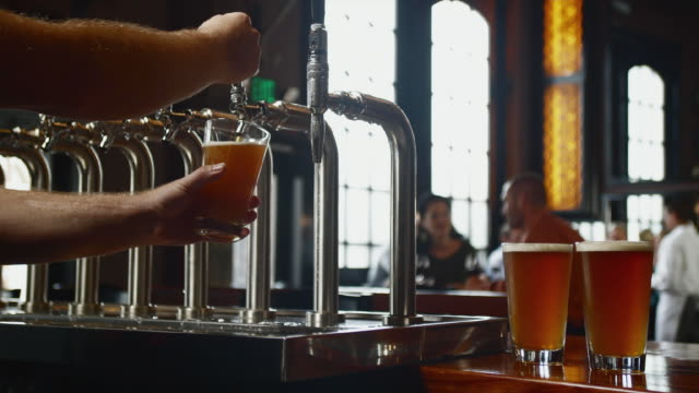 cu bartender pouring beer from tap / seattle, washington, usa - seattle stock videos & royalty-free footage
