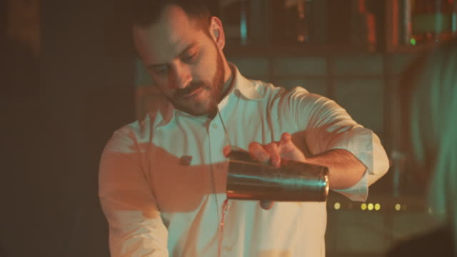 bartender pouring drink 4k - bartender stock videos and b-roll footage
