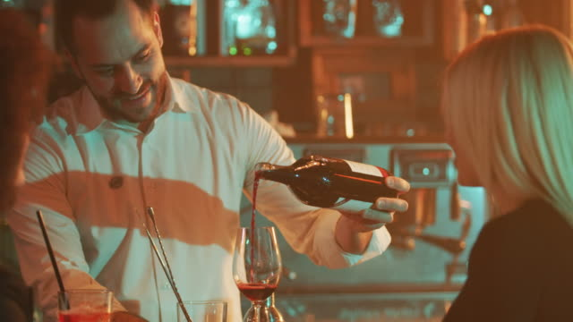 Bartender pouring red wine 4K