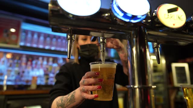 bartender pours a beer at switch bar on april 12, 2021 in newcastle upon tyne, united kingdom. england has taken a significant step in easing its... - beer alcohol stock videos & royalty-free footage