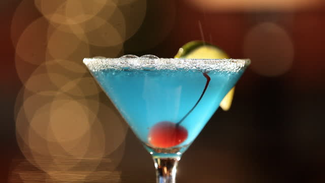 a bartender pours a martini into a glass. - bartender stock videos and b-roll footage