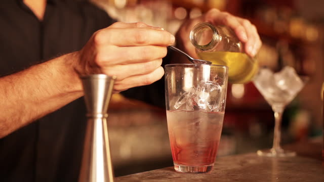 bartender preparing cosmopolitan - one mid adult man only stock videos & royalty-free footage