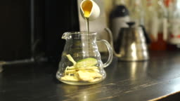 Bartender Preparing Healthy Tea with Honey