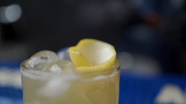 bartender putting slice of lemon in a cold drink - glove stock videos & royalty-free footage