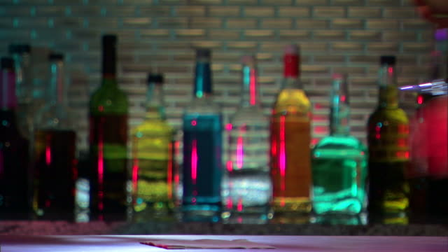 bartender serves margarita at bar. - margaritas stock videos and b-roll footage
