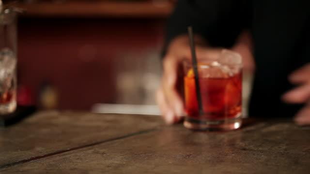 Bartender serving negroni