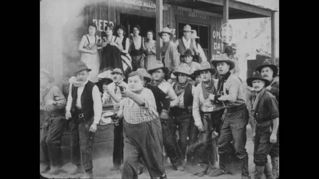1918 Bartender (Fatty Arbuckle) shoots at the bandits as they take off on horseback