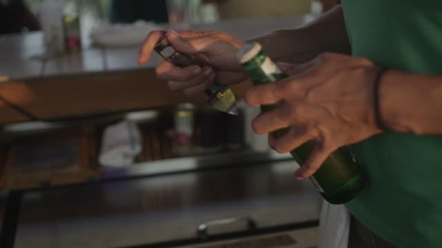 bartender taking cap off beer bottle - beer cap stock videos & royalty-free footage