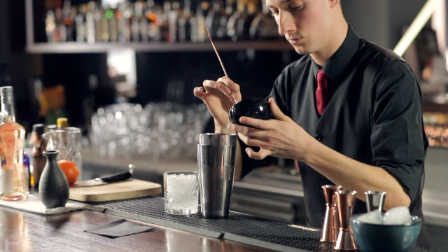 bartender taking grated cocktail ingredient with long spoon - grated stock videos & royalty-free footage