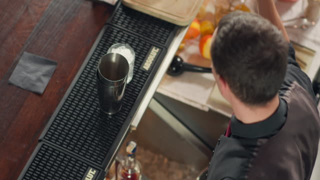 bartender taking grated ginger with long bar spoon - grated stock videos & royalty-free footage