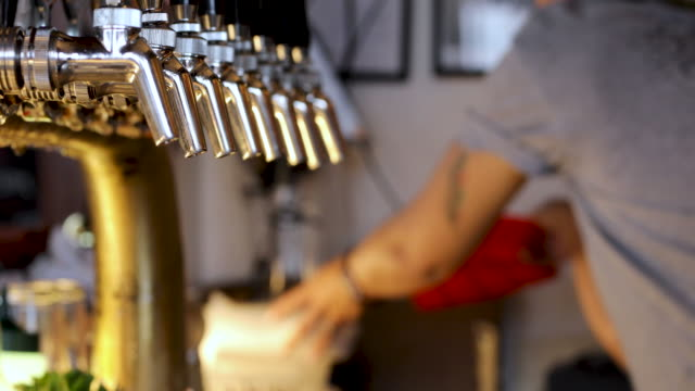 bartender using point of sales machine in background - pub stock videos & royalty-free footage