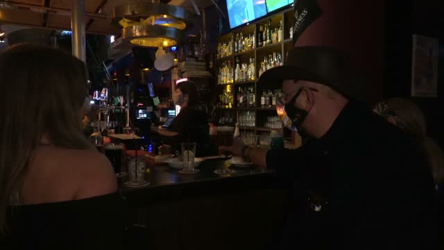 bartender wearing mask for protection against covid-19 serves beer at mike's place bar on march 07, 2021 in jerusalem, israel. following israel's... - economy stock videos & royalty-free footage