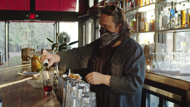 Bartender with Bandana Over Face During Covid-19 Pandemic