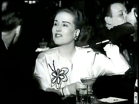 bartender working behind bar. woman w/ cigarette holder in conversation w/ man. bartender mixing drink in shaker glass stiring pouring whisley into... - manhattan stock videos & royalty-free footage