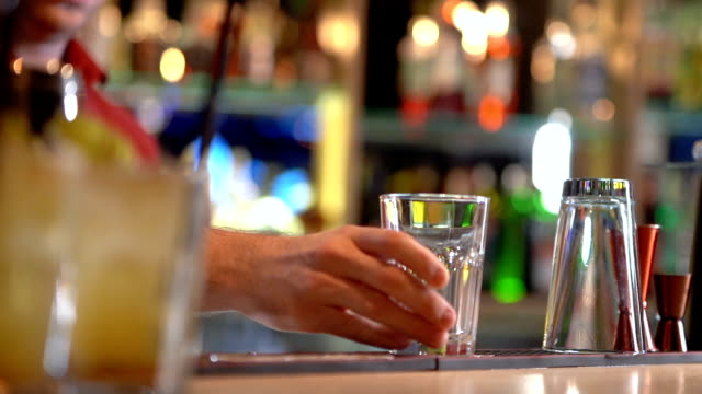 bartender working in bar counter - mixing stock videos & royalty-free footage