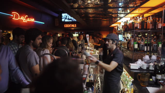 bartenders serving at bar - mirrored ceiling - san francisco - bar video stock e b–roll