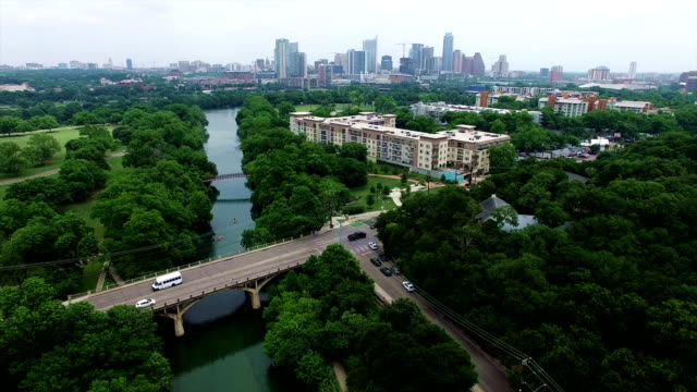 Barton Springs with Austin Cityscape Skyline Aerial Shot of High Above Barton Creek Texas Hill Country Paradise 4K