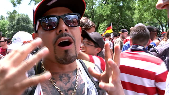 Football fever grips the USA USA Washington DC US fans applauding at the end of the game Vox pops SOT Fans gathered in park to watch game Reporter to...
