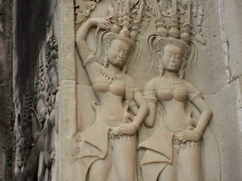 cu, bas relief carvings of apsaras at temple, angkor wat, cambodia - bas relief stock videos & royalty-free footage
