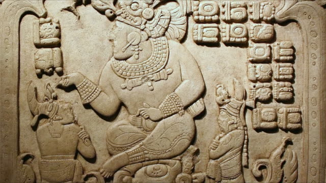 bas relief depicting a god and people - mittelamerika stock-videos und b-roll-filmmaterial
